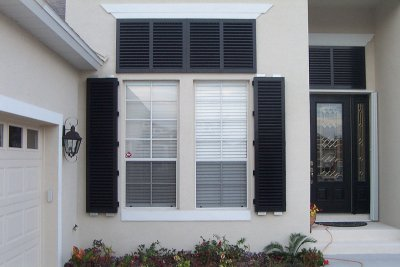 Open shutters on house windows